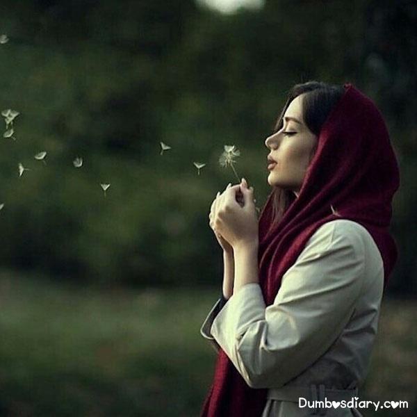 Beautiful hijabi girl in green fields