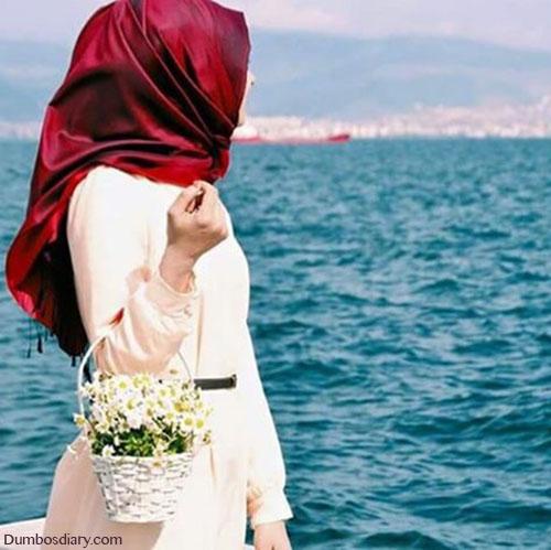 Hijabi girl near ocean