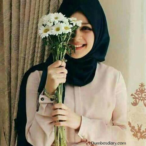 beautiful hijabi girl with flowers