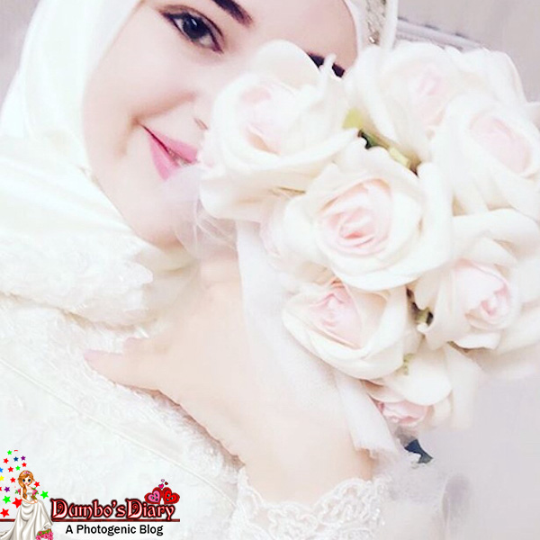 Pretty Hijabi Girl With Baby Pink Rose