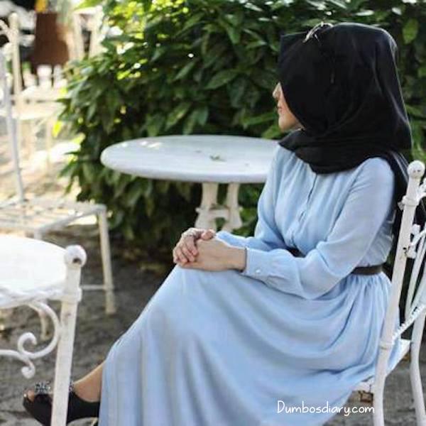 Hijabi Girl Sitting On Chair