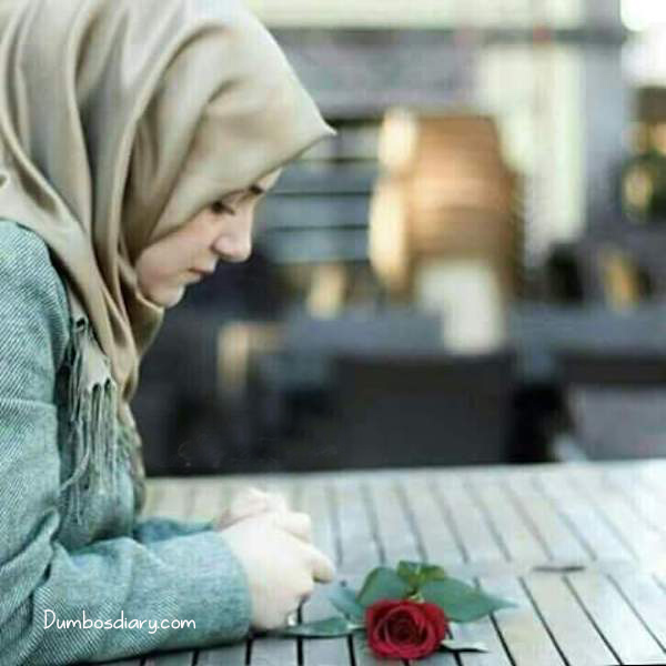 Sad hijabi girl waiting for someone